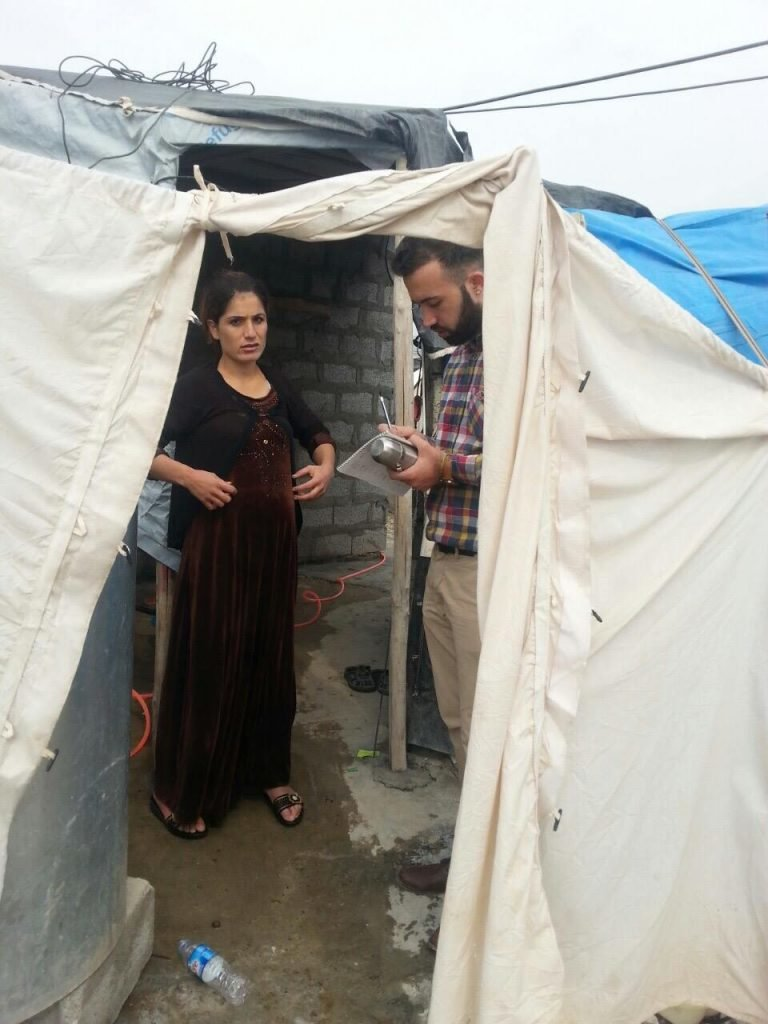 Ayaz interviewing a female Yazidi refugee / photo provided